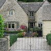 """The emperor Hirohito of Japan once visited Bibury in the 1930s, and liked it very much.  This has helped make the village popular with Japanese tourists.  We were told that so many of them were overrunning people's yards, walking into their gardens to take pictures, that people resorted to putting up """"Keep Out"""" signs in Japanese."""