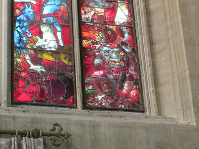 The lower part of the Last Judgment window shows the devils and the torments that await you in Hell if you aren't good.  I think that is Satan himself in the lower right, complete with a second face in the middle of his chest.  Imagine being a little kid in that church and staring at that window all through the service.