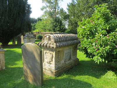 "This type of chest tomb is specific to the Cotswolds.  It's a ""bale tomb,"" with the rolled top said to represent wool bales."