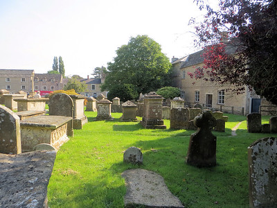 """I was very excited to walk around in the old churchyard beside the church.  Our tour leader, John Hudson, told me that churchyards were usually located on the south side of the church, the """"good side.""""  The north side was the devil's side and nobody wanted to be buried there.  Sometimes this led to the ground on the south side of the church being raised higher due to the number of burials there."""
