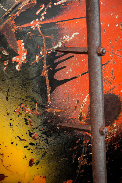 ABSTRACT VIEW OF AN OLD PROPANE TANK AND FARM IMPLEMENT.