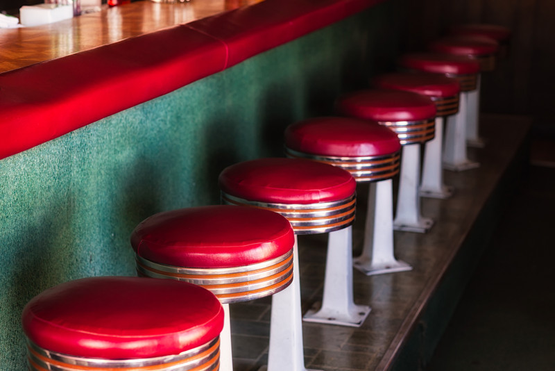 GRAB A STOOL IN GRUMPY'S.