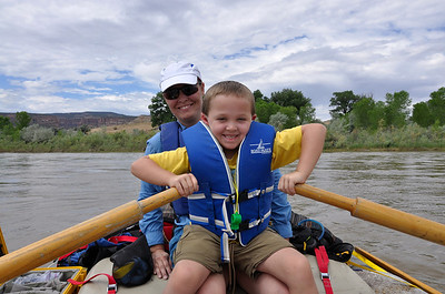 Jack assists Lynne with the rowing on the Colorado River.