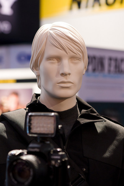Mannequin demoing Manfrotto tripods.