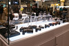 Sony's New technology booth including lens mockups and NEXes with adapters.
