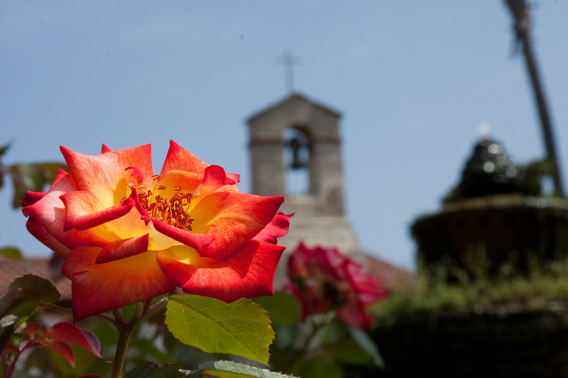 Flower, church and fountain in forced perspective macro shot
