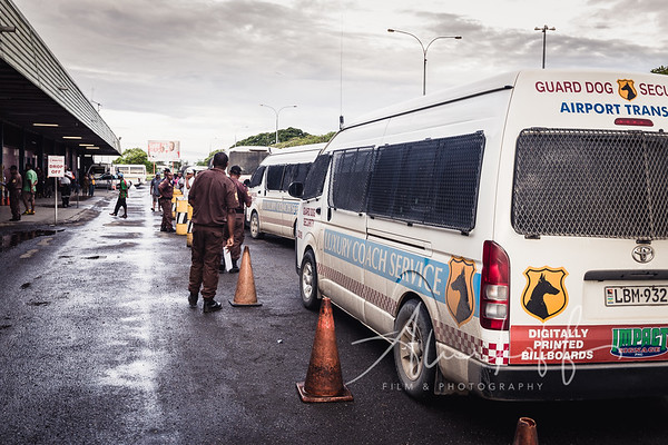 Lae Nadzab Airport shuttle service with heavy security escorts.