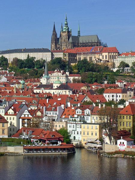 St. Vitus Cathedral (Prague Castle) on hilltop, Hergetova restaurant on water.