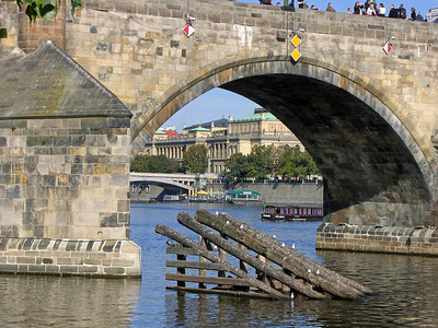 Looking NE through an arch of the Charles bridge to the east bank.