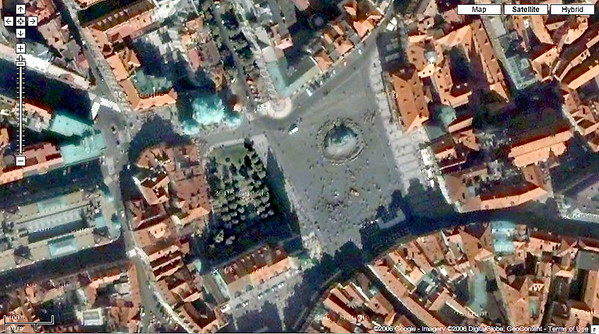 Satellite view of Old Town Square courtesy Google Maps. Jan Hus Monument is the circle in the square. Distance from building face at top of square to bottom of square is 400 feet. Clocktower shadow marks left side of square.  http://www.google.com/intl/en_us/help/terms_maps.html