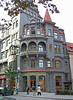 """A very Rococo building. Sign above the doors: Restaurant """"Street of the Old Synagogue"""""""