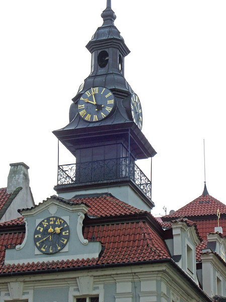 The Jewish Community Building  sports Roman and Hebrew clocks. The Hebrew clock runs counterclockwise.