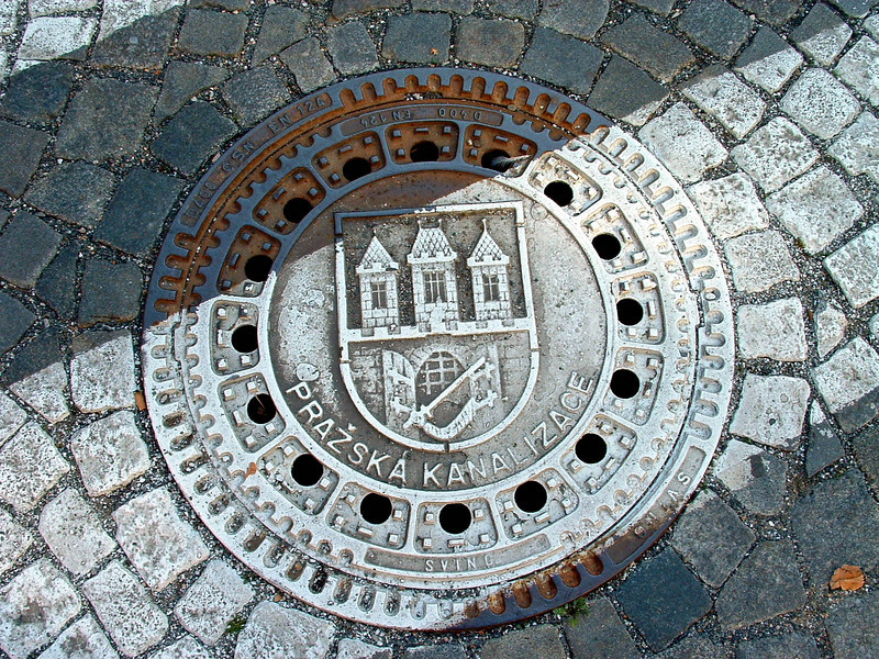The City seal seen on this Hastalska St. manhole cover.