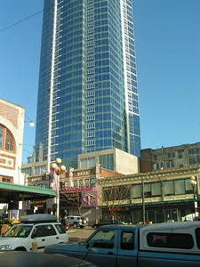 Modern office towers reach for the sky among late 19th and early 20th century commercial structures.