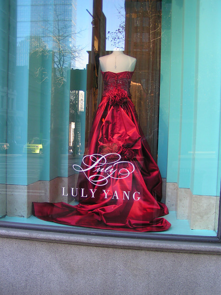 The fashionista in me (I am convinced one lurks inside every woman) cannot resist photographing the gowns. After all, who knows when I may need to have a crimson ball gown custom made for a special occasion.