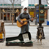 Street performer and his dog