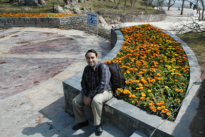 Suchit at the bed of flowers where one gets view of Islamabad from the Monal restaurant in Pir Sohawa, Islamabad, Pakistan