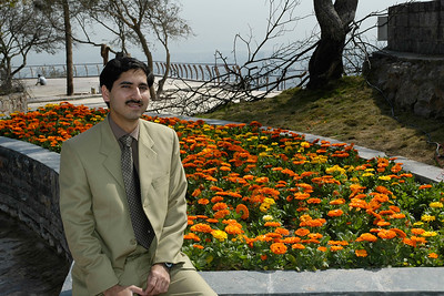 Mr. Irfan Hayes of COMSATS in front of a bed of flowers at Marghallas Hills. Islamabad, Pakistan