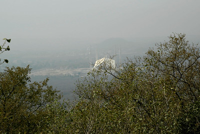 View from Marghallas Hills of Faisal Mosque, Islamabad. This is the largest mosque in Pakistan and South Asia and the fourth largest mosque in the world. Faisal Mosque is the National Mosque of Pakistan. It has a covered area of 5,000 sq mtr (54,000 sq ft) and has a capacity to accommodate approximately 300,000 worshippers (100,000 in its main prayer hall, courtyard and porticoes and another 200,000 in its adjoining grounds).   The Faisal Mosque is named after the late King Faisal bin Abdul Aziz of Saudi Arabia, who supported and financed the project.  Location: Islamabad, Pakistan.