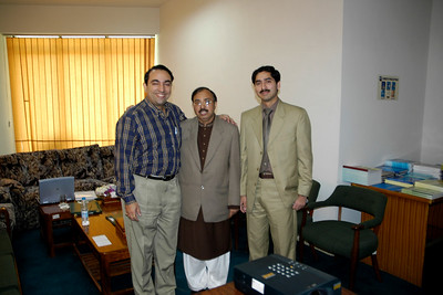 Tajammul Hussain and Mr. Irfan Hayes with Suchit Nanda at the COMSATS office.  COMSATS (Commission on Science and Technology for Sustainable Development in the South) is an international organization. It aims to reduce the ever-growing gap between the developed and developing world through useful applications of science and technology. Islamabad, Pakistan.  Website http://www.comsats.org.pk