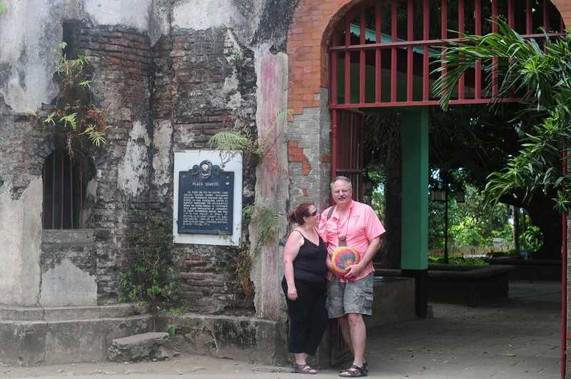 """At the entrance to <a href=""""http://thepausesbetween.com/2012/12/15/puerto-princesa-plaza-cuartel/"""">Plaza Cuartel</a>, a WW II historical site, in Puerto Princesa."""