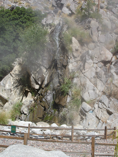 A small waterfall next to the lower station.  Misters give some relief from the 105+ lower temperature.
