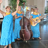 Renowned Hawaiian musical group Puamana welcoming attendees with a serenade in the lobby of the Hawaiian Prince Hotel.