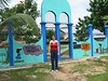 Joanna in front of a children's park.  It includes an above ground swimming pool, constructed by a local builder. It collapsed