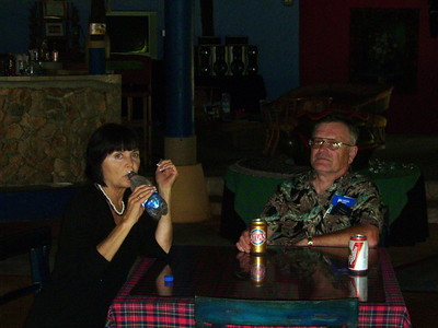 Two of our friends, Mary and Ron  try out the local beverages. The bottled water and Atlas and Balboa beers.