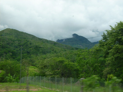 Panamanian countryside.  Very low clouds, they come in white, or dark and then clear out.