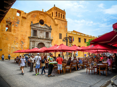 Santa Teresa square in the city with restaurant.  People look so happy, even the workers.