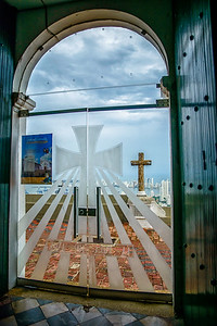Candelaria convent located on the top of the Popa hill... city below through window.