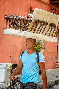 Vendor with spoons for sale.