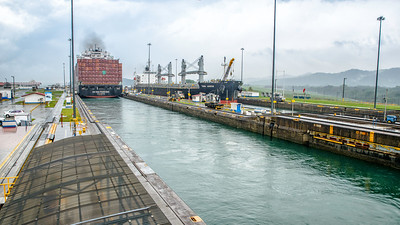 Ships pass in the two lanes of the canal, going same direction.