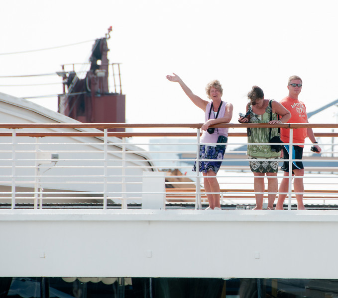 • Cartagena, Colombia<br /> • People waving to us from the Holland America Statendam ship as we leave port