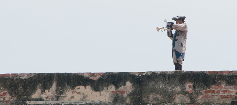 • Cartagena, Colombia<br /> • Man playing the trumpet at the top of Castillo San Felipe de Barajas Fortress