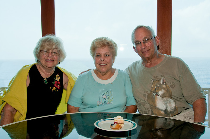 * Coral Princess<br /> * Gertrude, Sandy and Arnold at the Horizon Court Buffet lunch. I wonder who is going to have those 2 desserts?