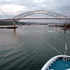 Cruise ship approaches Panama Canal Pan American bridge.