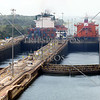 Cargo ships transit the lanes and lock chambers of the Panama Canal.