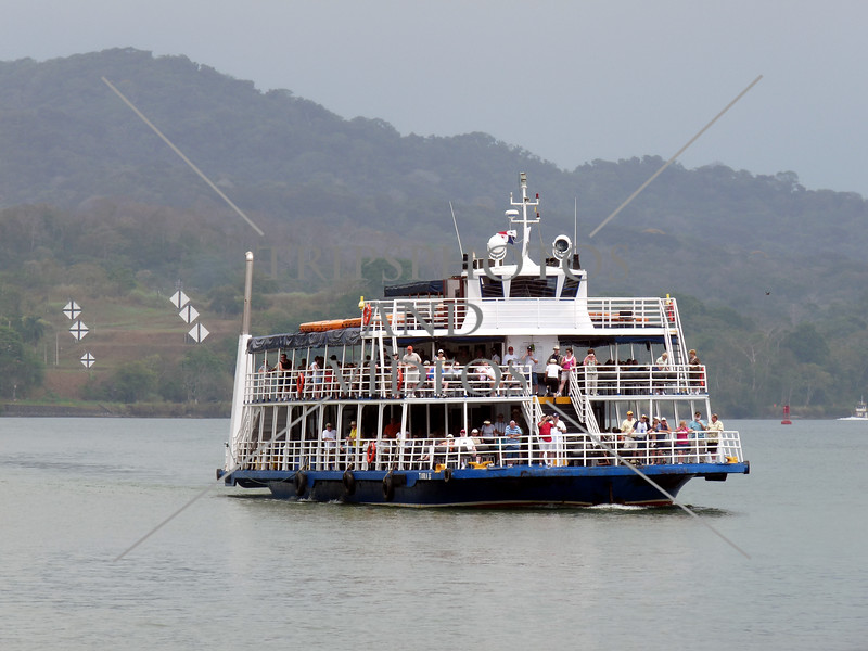 Tour boat transits the Panama Canal.