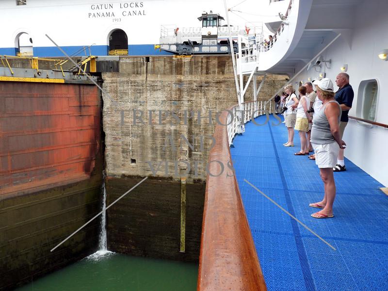 Cruise ship passengers viewing the Panama Canal Gatun lock gates and chamber.