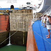 Cruise ship passengers viewing the Panama Canal Gatun lock gates and chamber.