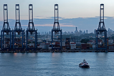 Shipping cranes, containers, and buildings in Panama City