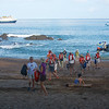 Caletas Reserve: Guests landing from Zodiac, toward Sea Lion