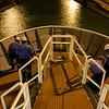 Deck crew untying ropes