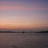 Panama Canal: Sunrise on Gatun Lake with ship approaching