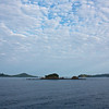 Isla Coiba: Approaching Granito de Oro, with clouds