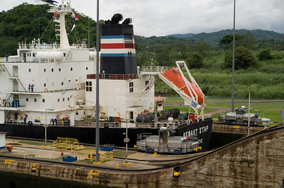 Container vessel exiting the Panama canal at Miraflores Locks, Panama City, Panama