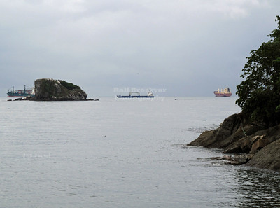 Amador Causweay, Flamenco Island, Panama City, Panama; Ships lining up at the Pacific entrance of the Panama Canal