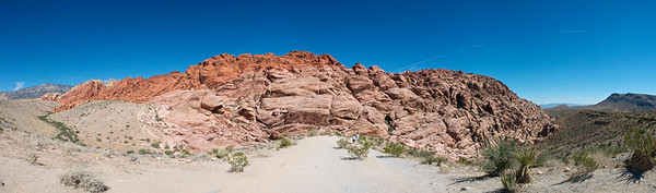 A 180° panorama of Calico Hills at Red Rock Canyon Conservation Area, Nevada, USA.  Stitched together from 21 handheld shots. For some scale, the people in the center of the photo are less than 30 meters away from me.